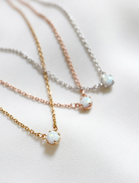 close up of opal necklace in gold, rose gold, silver
