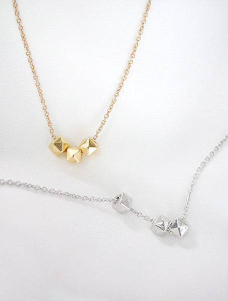 gold and silver cubix necklaces