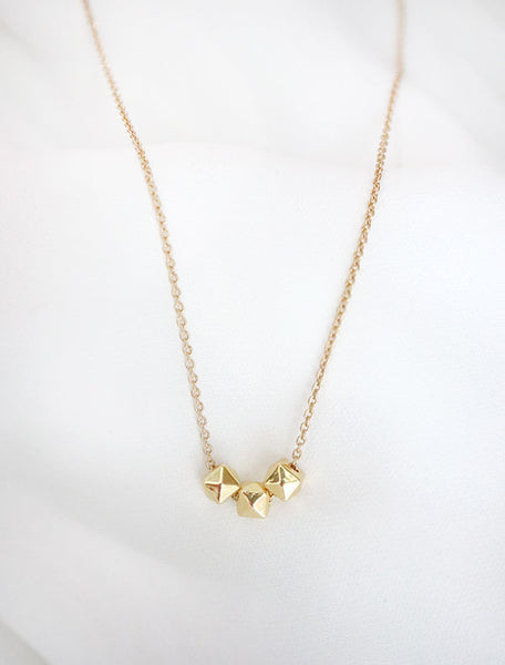 gold cubix necklace