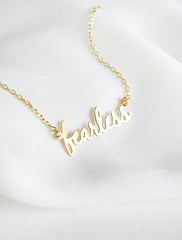 gold fearless necklace