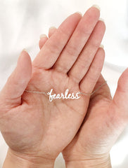 fearless necklace in hand