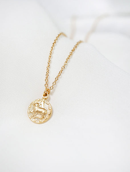 tiny gold horoscope necklace close up