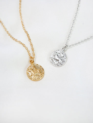 tiny horoscope necklace in gold and silver