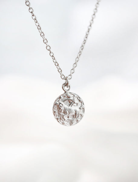 silver horoscope necklace hanging
