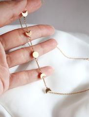 gold filled moon phase necklace in hand