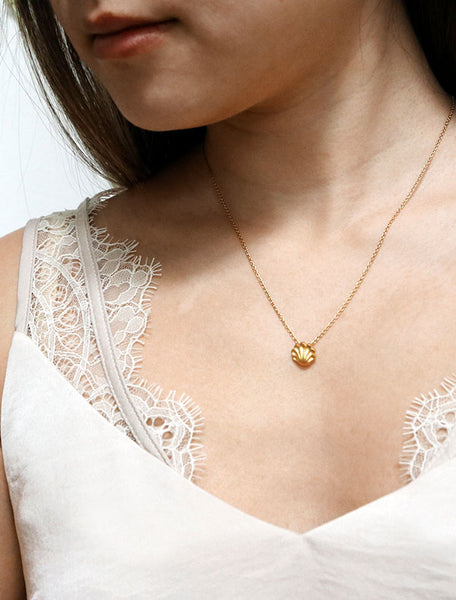 gold seashell necklace modelled