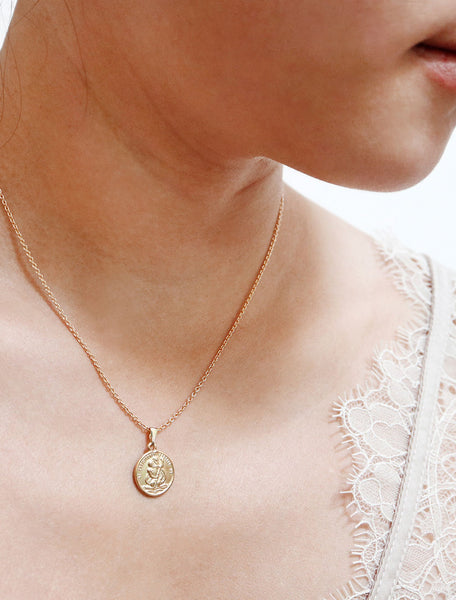 tiny st christopher coin necklace modelled
