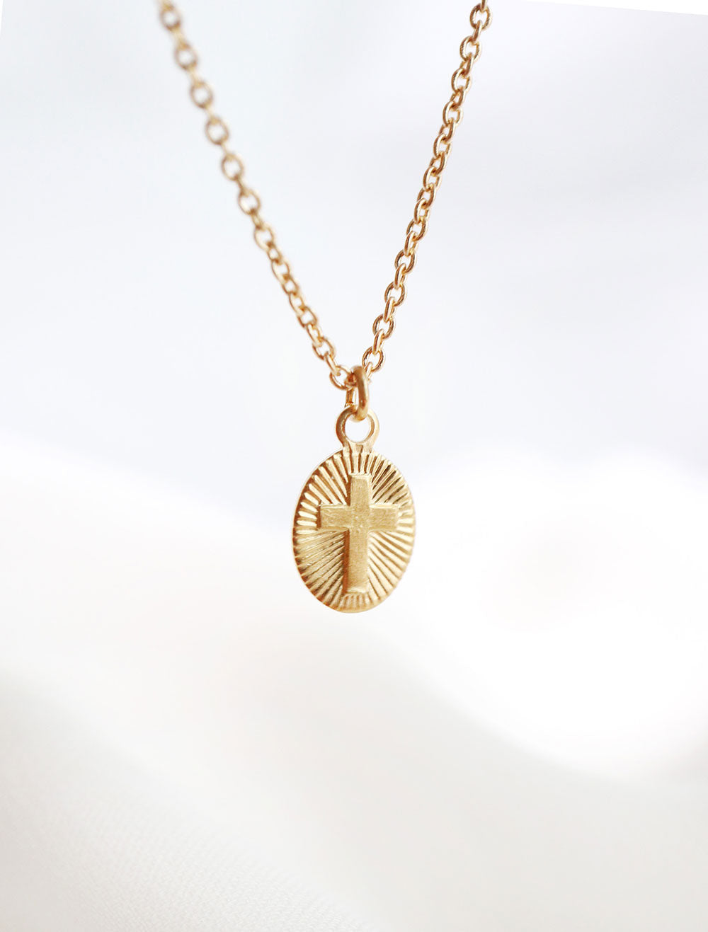 14k gold filled tiny starburst cross necklace