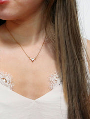 gold triangle crystal necklace modelled