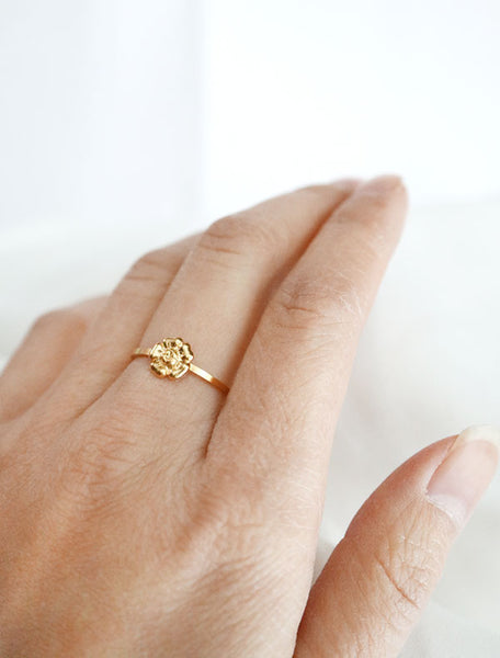 gold flower stacking ring worn