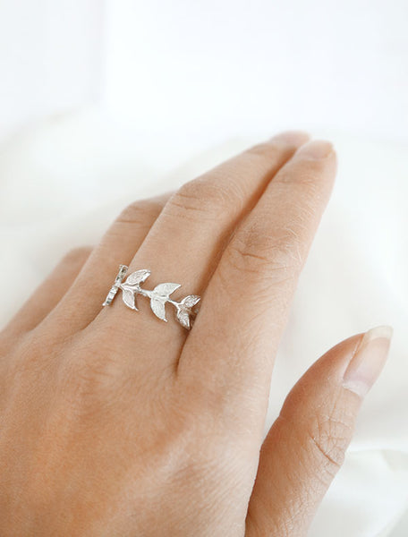 silver branch ring worn