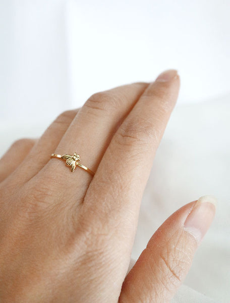 gold bee ring worn