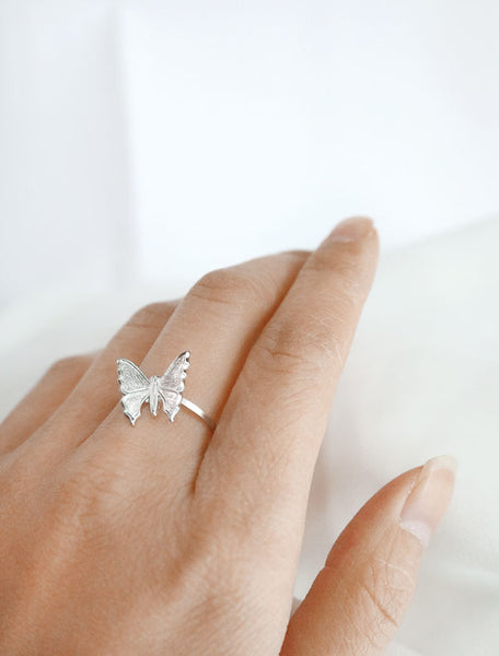 silver butterfly ring worn