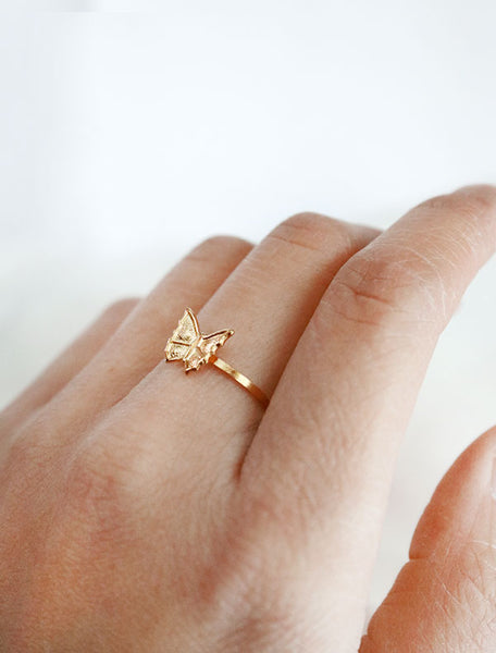 tiny gold butterfly ring worn