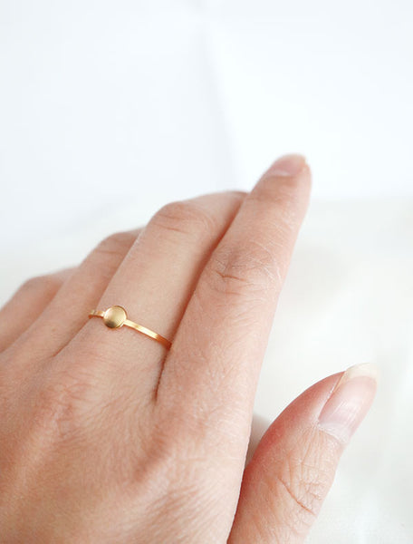 gold circle disc ring worn