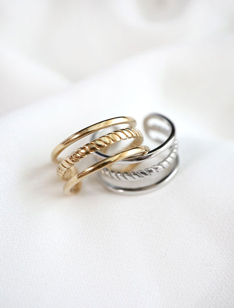 gold and silver cage rings