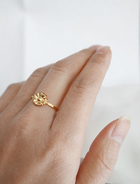 gold daisy stacking ring worn