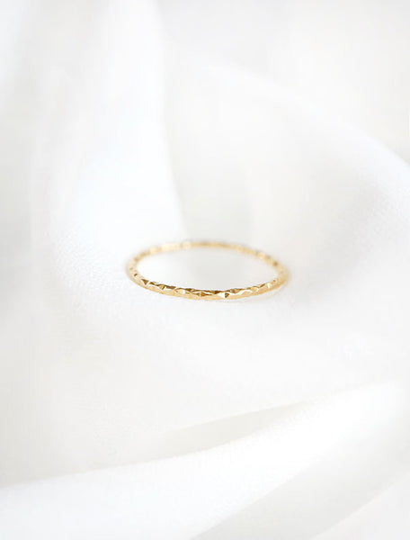 gold micro faceted ring band