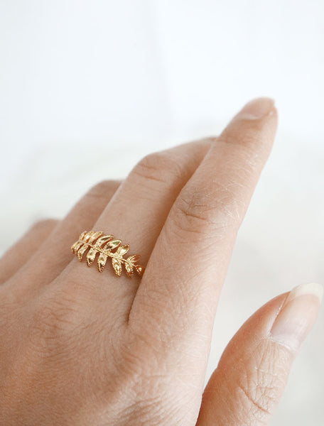 gold fern leaf ring worn