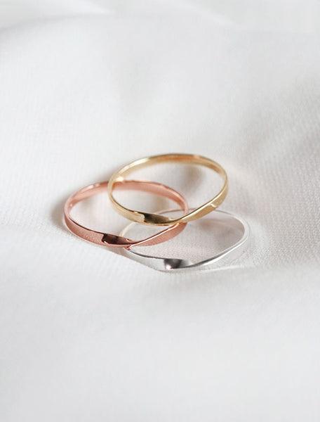 flat twisted rings in sterling, yellow gold vermeil and rose gold vermeil