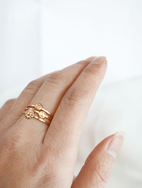 gold hippie stacking rings worn