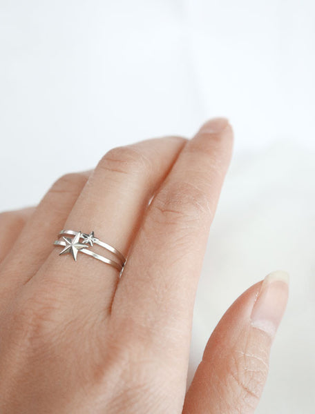 silver star stacking rings worn