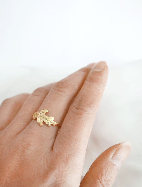 gold oak leaf ring worn