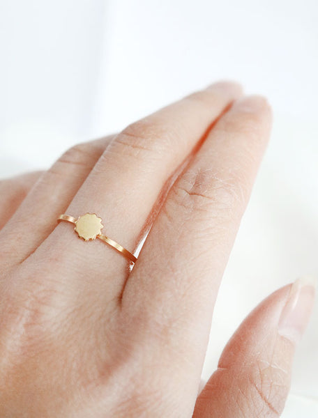 gold scalloped disc ring worn