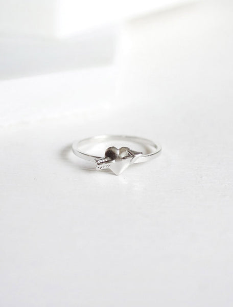 silver heart with arrow ring