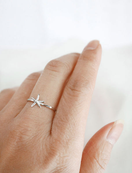 silver starfish ring worn