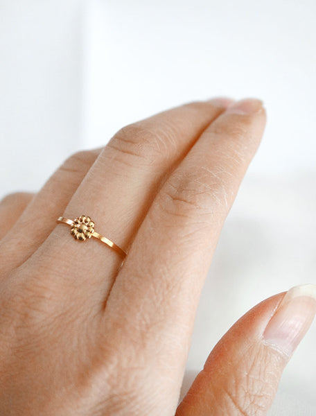 gold tiny daisy ring worn
