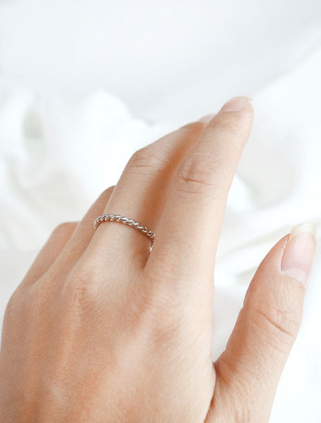 silver twisted rope ring worn