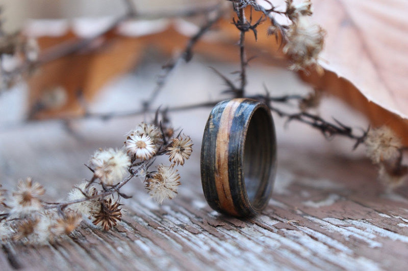 Weathered whiskey barrel ring with natural inlay