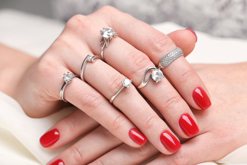 Woman wearing multiple wedding rings