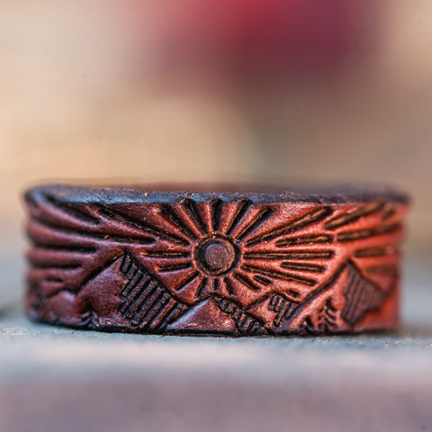 irish claddagh leather ring with mountain design in chicago tan