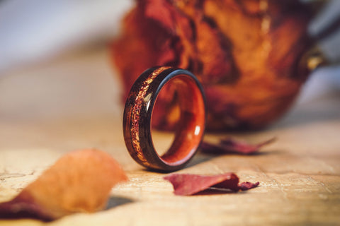 rustic wedding ring wood and rose petals
