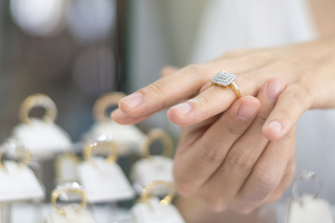 woman trying on engagement ring