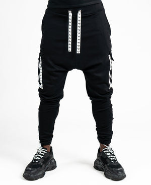 Black trousers with white logo