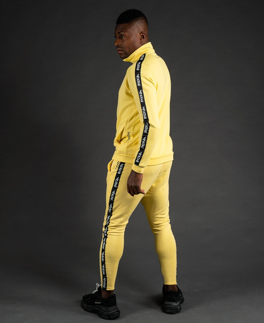 Yellow tracksuit with big F-sign