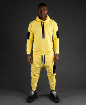 Yellow tracksuit with black pockets