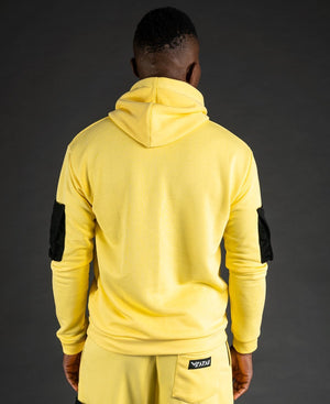 Yellow sweater with black pockets