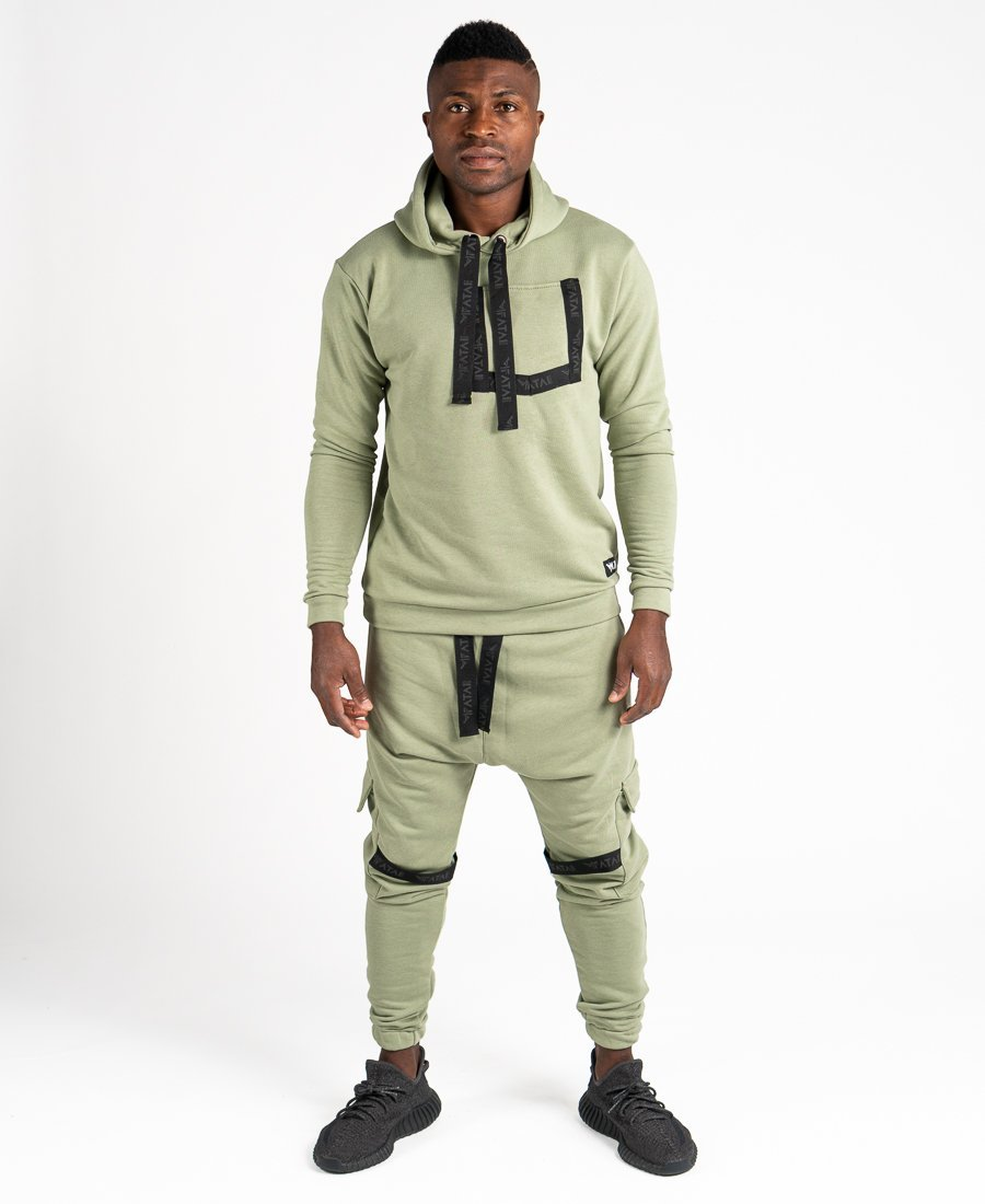 Green tracksuit with black design and side pockets