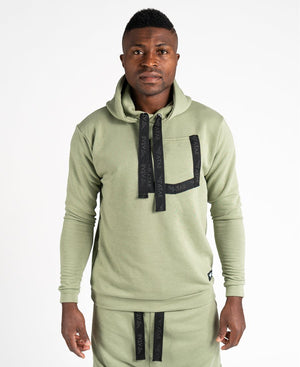 Green sweater with black design and pocket