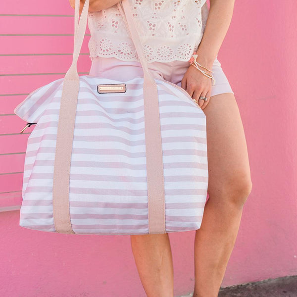<i>the</i> BON VOYAGE DUFFLE <i>blush and white stripe</i>