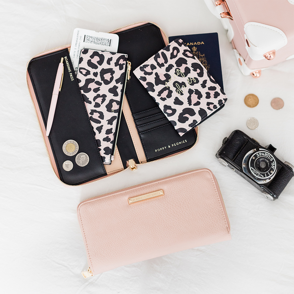 <i>the</i> WANDERLUST TRAVEL WALLET <i>blush</i>