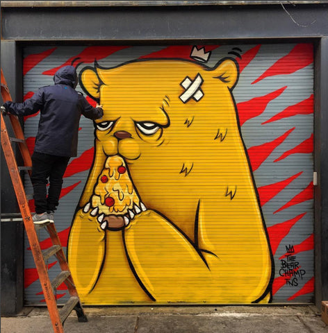 Picture of JC Rivera painting his iconic bear character