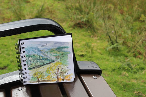 Drawing of forest scenery on a bench