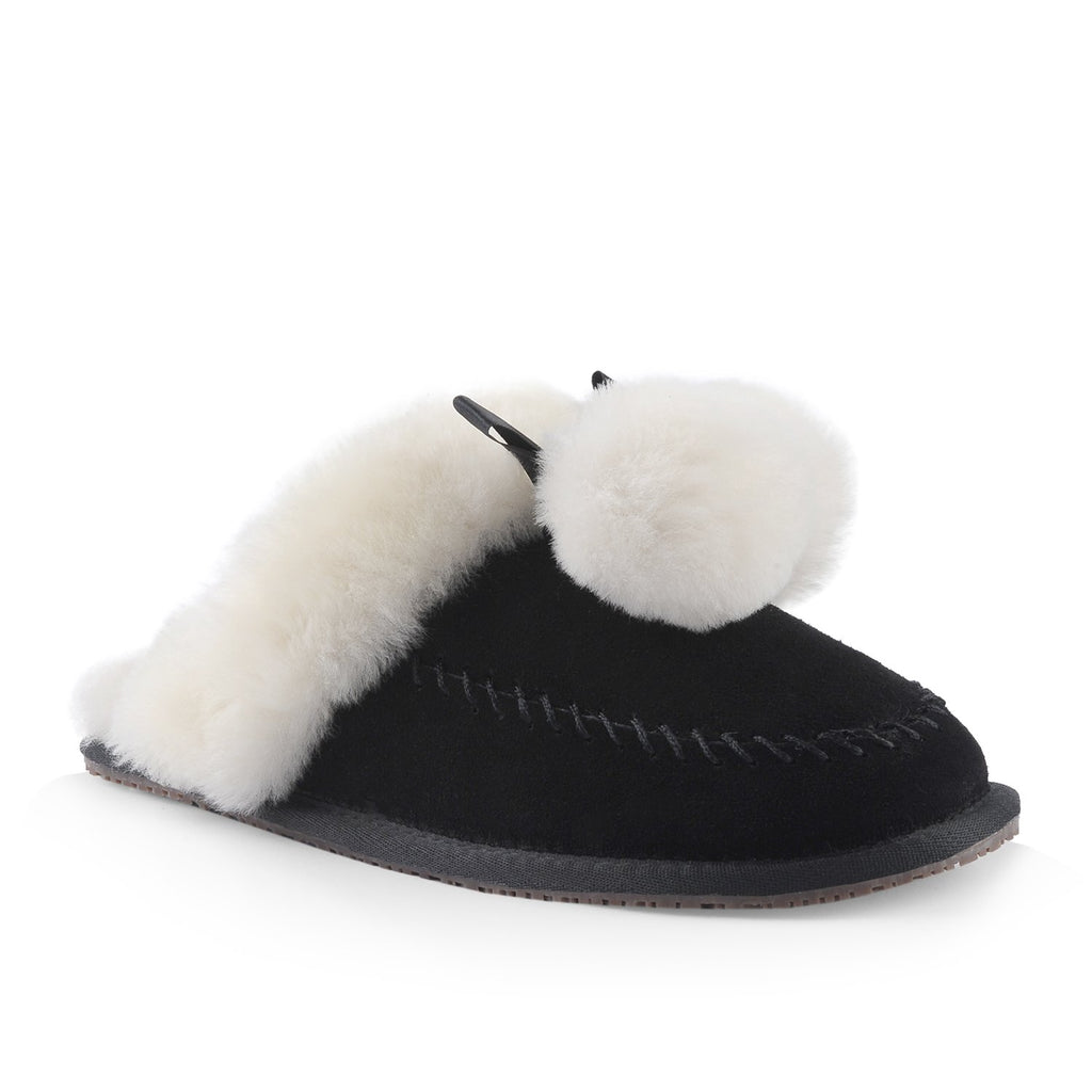 Nuknuuk leather slipper in black with white sheepskin pom poms and trim