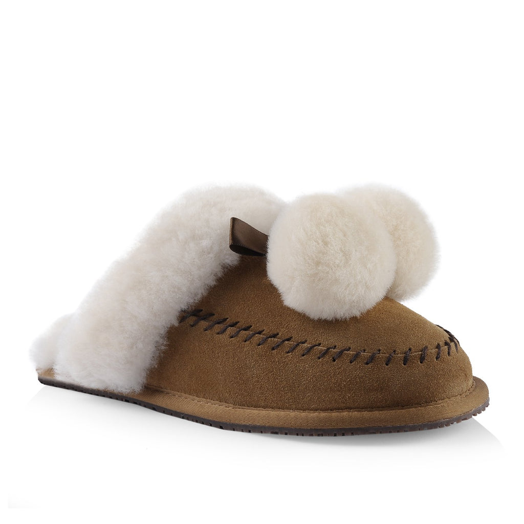 Nuknuuk leather slipper in chestnut colour with champagne sheepskin pom poms and trim