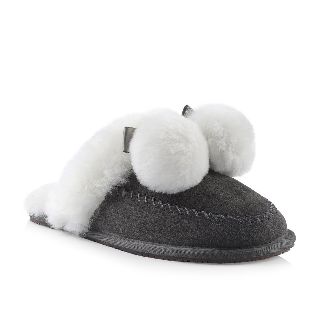 Nuknuuk leather slipper in grey with white sheepskin pom poms and trim